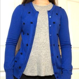 blue cardigan with black bows